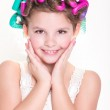 Lovely little girl portrait in curlers and pajamas, skincare kid beauty and glamour. — Stock Photo #37930479