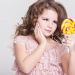 Funny child with candy lollipop, happy little girl eating big sugar lollipop, kid eat sweets. surprised child with candy. — Stock Photo #37930541