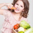 Happy little girl with basket of vegetables, — Stock Photo #37930579