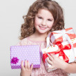 Cute little girl with birthday gift box. — Stock Photo #37930583