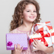 Cute little girl with birthday gift box. — Stock Photo #37930585
