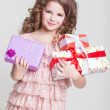 Cute little girl with birthday gift box. — Stock Photo #37930587