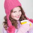 Beautiful child in winter hat drinking hot chocolate, little girl in woolen accessories with cup of tea or cocoa. — Stock Photo #37930673