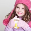 Beautiful child in winter hat drinking hot chocolate, little girl in woolen accessories with cup of tea or cocoa. — Stock Photo