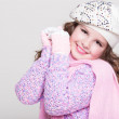 Lovely little girl in winter knitted hat pink scarf gloves and colorful cozy sweater. — Stock Photo #37930703
