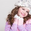 Lovely little girl in winter knitted hat pink scarf gloves and colorful cozy sweater. — Stock Photo #37930709