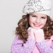 Lovely little girl in winter knitted hat pink scarf gloves and colorful cozy sweater. — Stock Photo #37930713