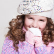 Lovely little girl in winter knitted hat pink scarf gloves and colorful cozy sweater. — Stock Photo #37930719