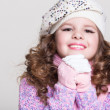 Lovely little girl in winter knitted hat pink scarf gloves and colorful cozy sweater. — Stock Photo #37930723