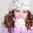 Lovely little girl in winter knitted hat pink scarf gloves and colorful cozy sweater. — Stock Photo #37930727