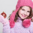 Lovely winter little girl with christmas tree toy. — Stock Photo