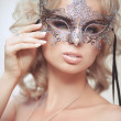 Vogue style portrait of beautiful delicate woman in venetian mask and fashionable dress. — Stock Photo #37931183