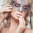 Vogue style portrait of beautiful delicate woman in venetian mask and fashionable dress. — Stock Photo #37931185