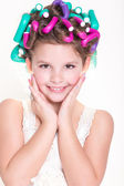 Lovely little girl portrait in curlers and pajamas, skincare kid beauty and glamour. — Stock Photo