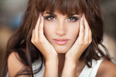 Beautiful young brunette woman close up. portrait or pretty happy girl in cafe. — Stock Photo