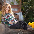 Beautiful pregnant woman relaxing outdoors in park — Stock Photo #38380407