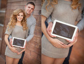 Pregnant woman with husband holding ultrasound scan on her tummy — Stock Photo