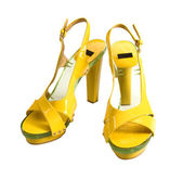 Transparent soled yellow patent leather high heels — Stock Photo