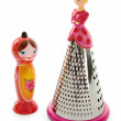Stock Photo: Dolly salt shaker and grater