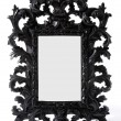 Baroque black painted carved wood mirror frame — Stock Photo