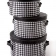 Set of houndstooth check and black leather bandboxes — Stock Photo #23122868