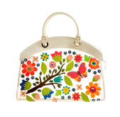 Transparent white leather handbag with colorful leather flowers — Stock Photo