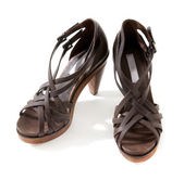 Wooden high heeled brown leather sandals pair — Stock Photo