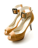 Elegant ankle strap nude peep toe bone stilettos pair — Stock Photo
