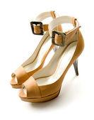 Elegant ankle strap nude peep toe bone stilettos pair — Stock Photo