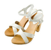 Wooden soled white leather high heeled elegant sandals — Stock Photo
