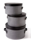 Set of houndstooth check and black leather bandboxes — Stock Photo