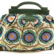 Стоковое фото: Flowery canvas and leather handbag