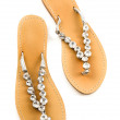 Stock Photo: Big carved crystals flip flop sandals
