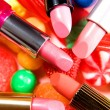 Beauty still life candies lipsticks composition - Zdjęcie stockowe