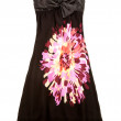 Strapless black dress with big colorful flower — Stock Photo #23632247