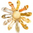 Royalty-Free Stock Photo: Sun shaped golden sandals still life fashion composition