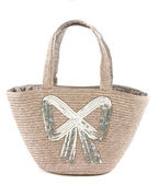 Big silver sequins bow raffia basket tote — Stock Photo