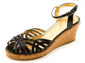 Black patent leather cork wedged sandal — Stock Photo