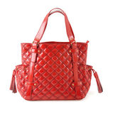 Padded red patent leather handbag with tassels — Stock Photo