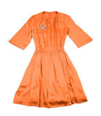 Satin tangerine evase pleated dress with diamonds brooch — Stock Photo