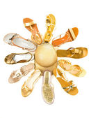 Sun shaped golden sandals still life fashion composition — Stock Photo