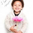 Child with big smile and big pink flower with I love mum message — Stock Photo