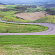 Winding road in Tuscany landscape — Stockfoto