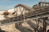 Machine in the quarry rag — Stock Photo
