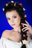 Portrait of young brunette girl with long hair — Stock Photo
