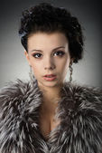 Portrait of a young girl in a fur coat — Stock Photo