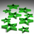 3D Green stars isolated on white background — Stockfoto