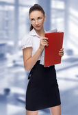 Young woman secretary at work at the office — Stock Photo