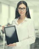 Businesswoman working with laptop at the office — Stock Photo