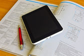 Tablet over engineering diagram — Stock Photo